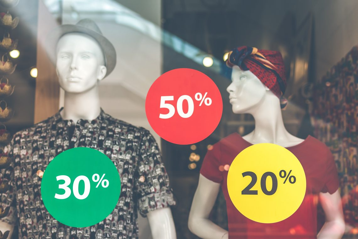 Mannequins with discount signs to illustrate how to stop a fear of missing out on margins from ruining your budget