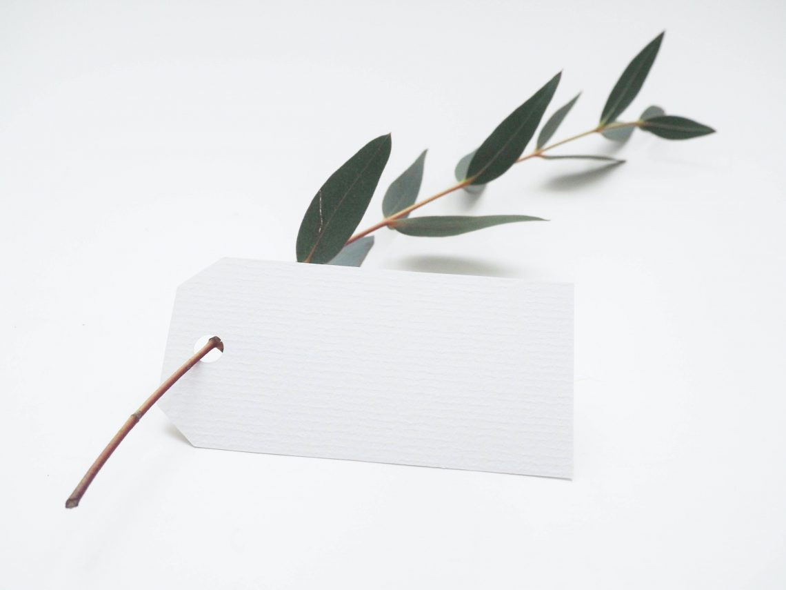 Twig with a gift tag to illustrate how to approach Christmas gifts as a minimalist