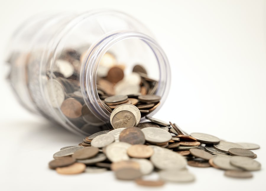 Jar with coins to illustrate the envelope system